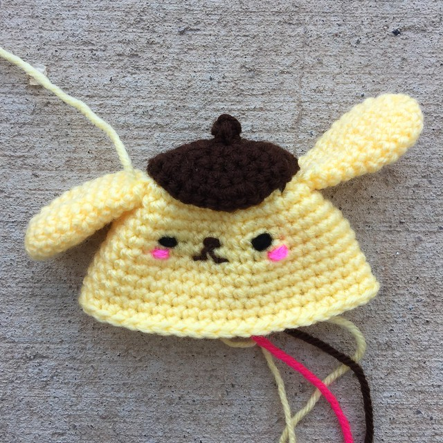 A future amigurumi Purin with facial features, ears, and beret attached