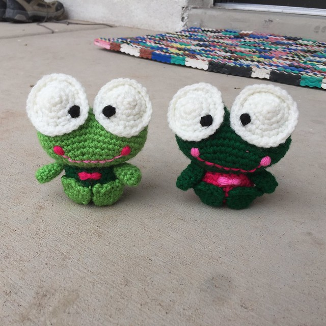 Two amigurumi frogs ready for adventure