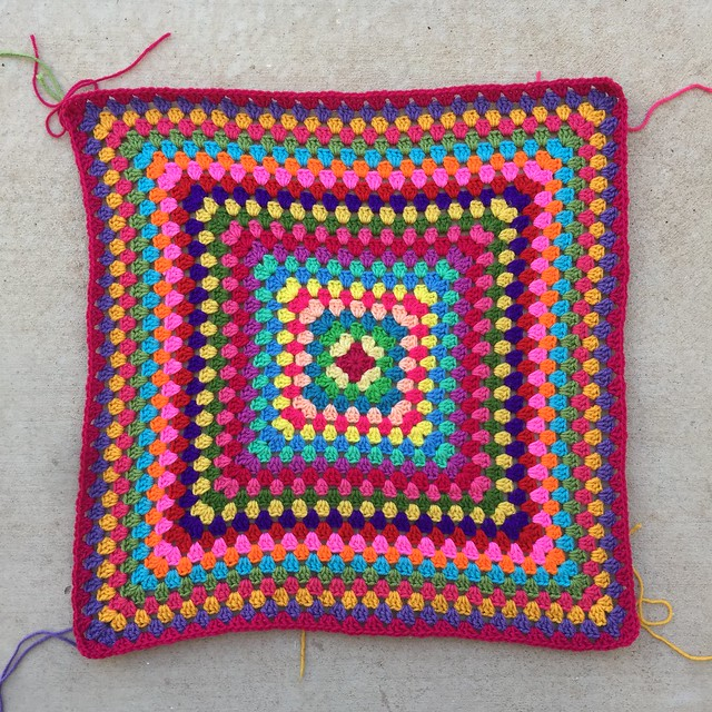 Twenty-four rounds of what will be a thirty-six round multicolor granny square blanket