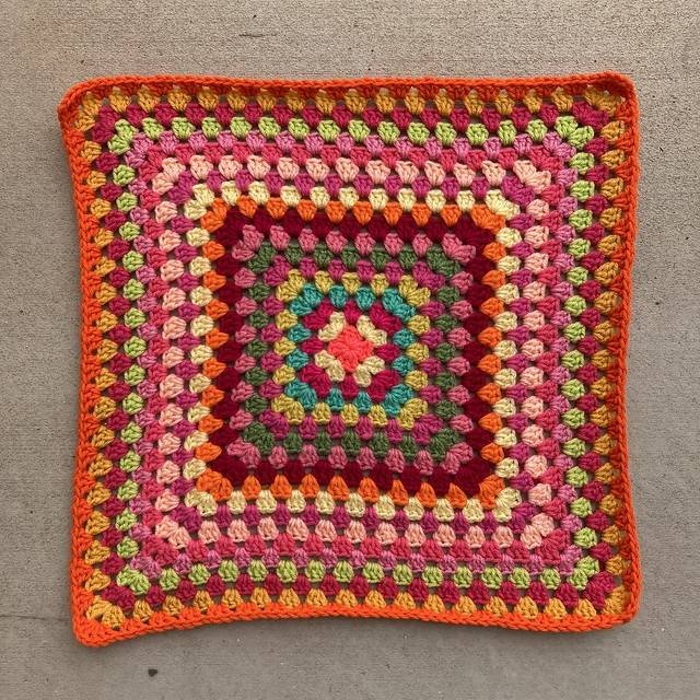 A round of vibrant orange for a granny square picnic blanket