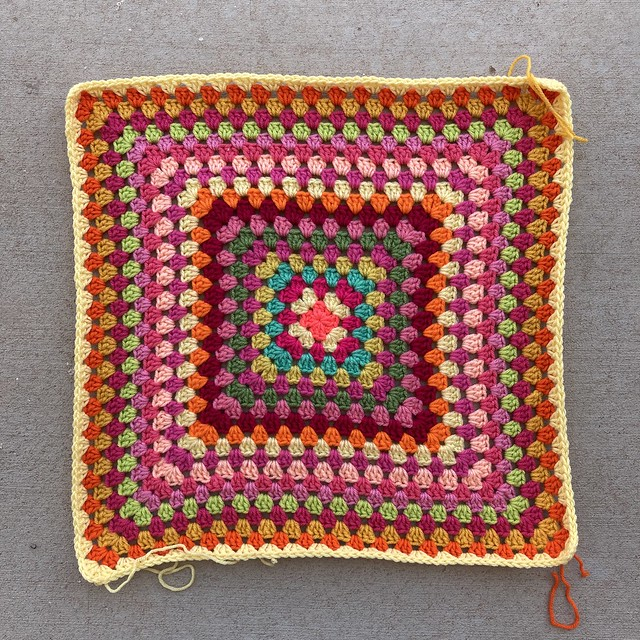 The twentieth round of a planned thirty-six round multicolor granny square blanket