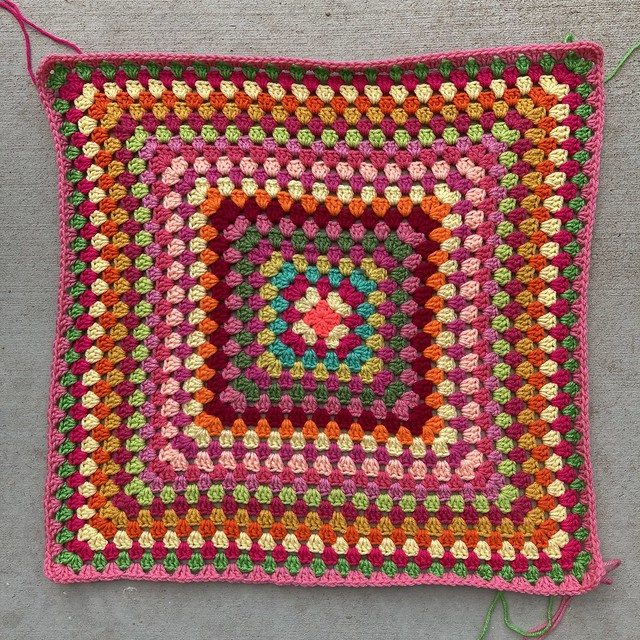 The first twenty-three rounds of a multicolor granny square blanket