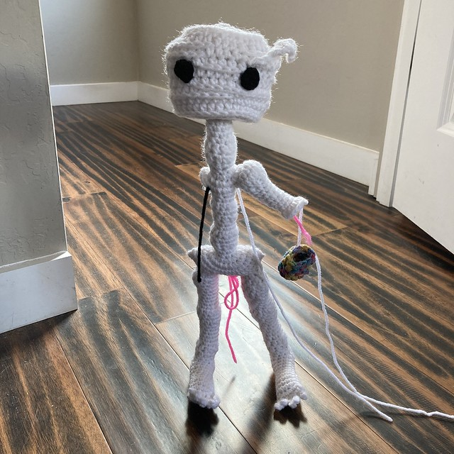 Mr. Headz waits in the doorway for me to finish crocheting his left arm