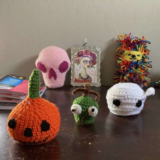 Three crochet heads for Mr. Bone Headz all in a row