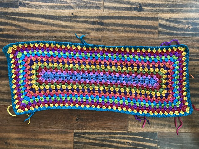 The fourteenth round of a future multicolor granny rectangle rug