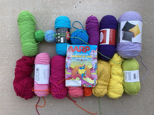 An assortment of yarns for a Peter Max inspired palette