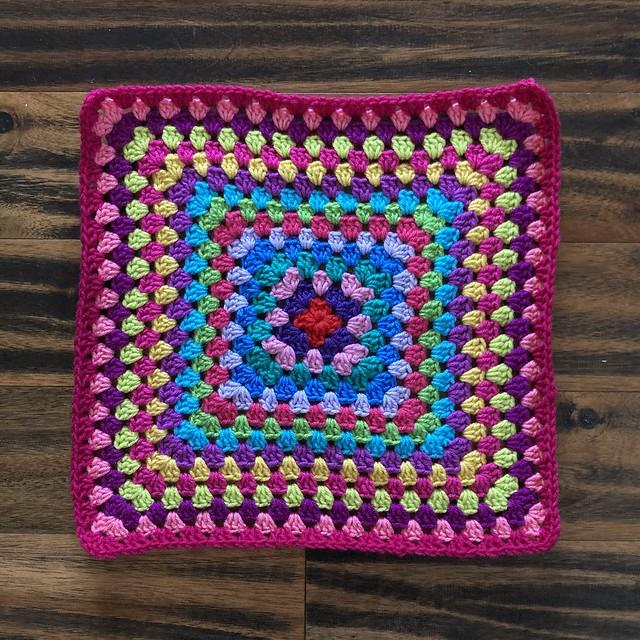 The central crochet square for a multicolor granny square cardigan