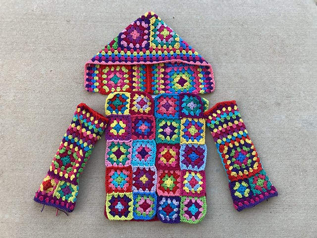 All of the pieces of a granny square cardigan