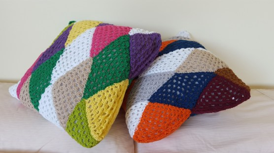 two triangle cushions leaning over
