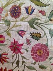 Silk chain stitches on cotton floor spread made by Gujarati craftsmen