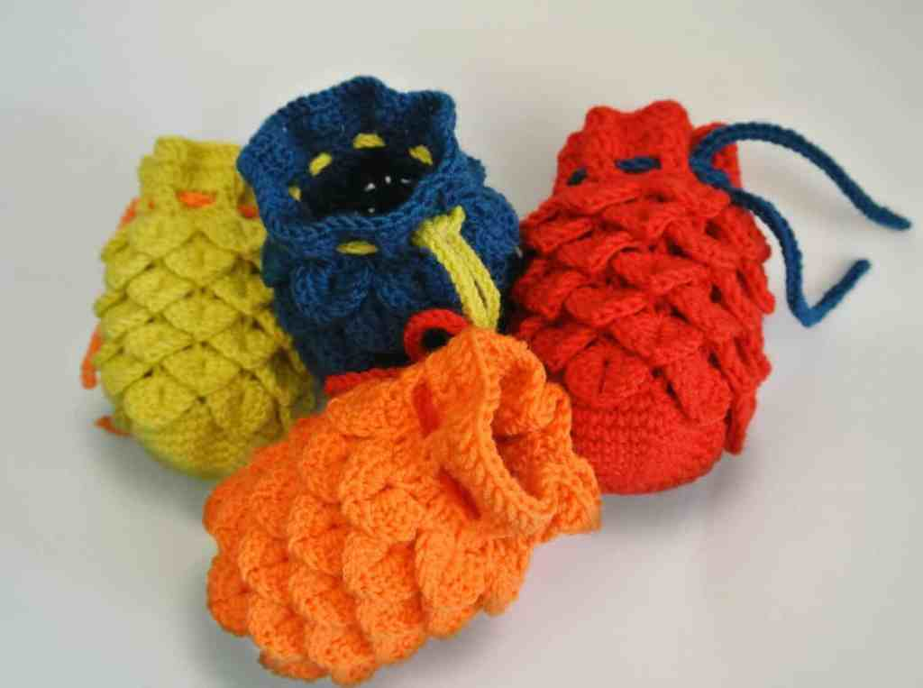 Image of four crocheted dragon egg dice bag
