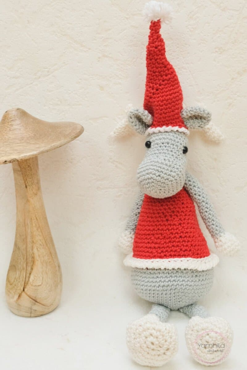 Pinterest photo of the crocheted Christmas elk wearing a red Santa hat