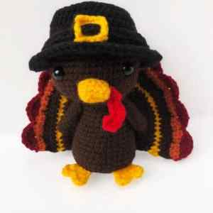 Put a smile on your little face this season with an adorable turkey stuffy. This Thanksgiving Turkey Crochet Pattern is just what you need to add some whimsy to your centerpiece or decorate a mantle. Amigurumi turkeys are a perfect addition no matter how you use them! #thanksgivingamigurumi #thanksgivingcrochetpattern #turkeyamigurumi #turkeycrochetpattern #freecrochetpattern #belacrochets #crochetpreneur #30daysofcozy #stuffedturkeycrochetpattern #turkeypattern