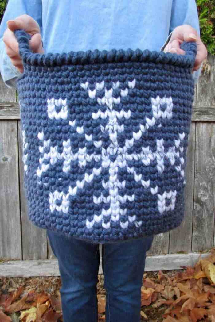 The Let it Snow Basket is great little project to brighten your decor throughout the fall and winter. The free pattern includes written instructions and charts for the medium size basket. #snowflakebasket #crochetbasket #christmasbasketcrochetpattern #christmasbasket #tapestrycrochet #tapestrycrochetbasket #freecrochetpattern #30daysofcozy #letitsnowbasket #tapestrycrochetbasketpattern #christmascrochetpattern #crochetpatternforfall