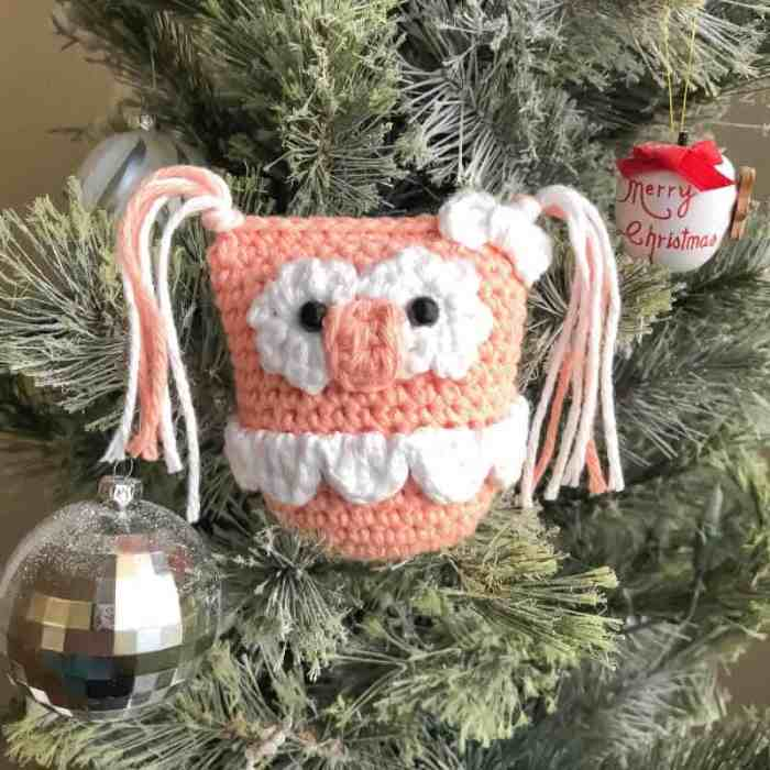 Photo of Owletta an amigurumi animal hanging on a Christmas tree