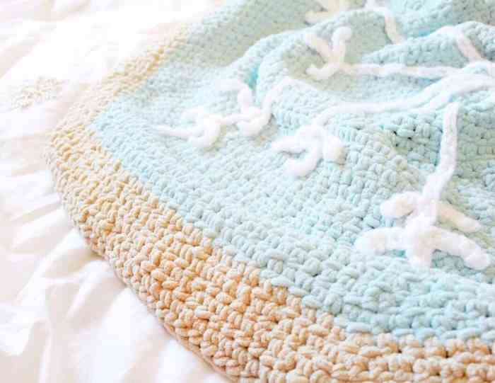 Close up photo of the Snowflake Sugar Cookie Blanket on a white sheet