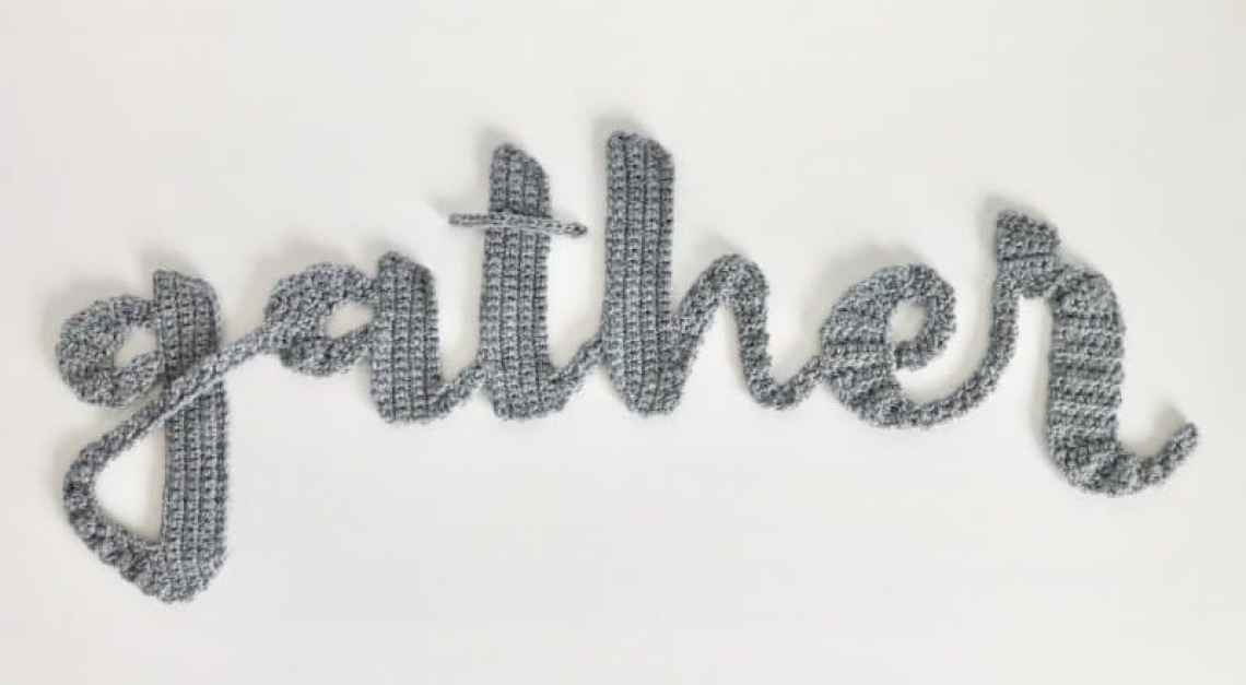 "Photo of the crocheted text ""gather"" with a white background"