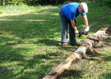 Bill Nelson flattening a log in the Sechler skills park