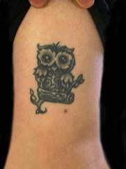 Healed owl tattoo. Outside leg. 2016
