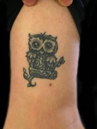Healed owl tattoo. Outside leg. 2016