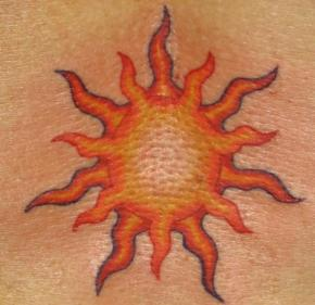 Sun tattoo. Lower back. 2009