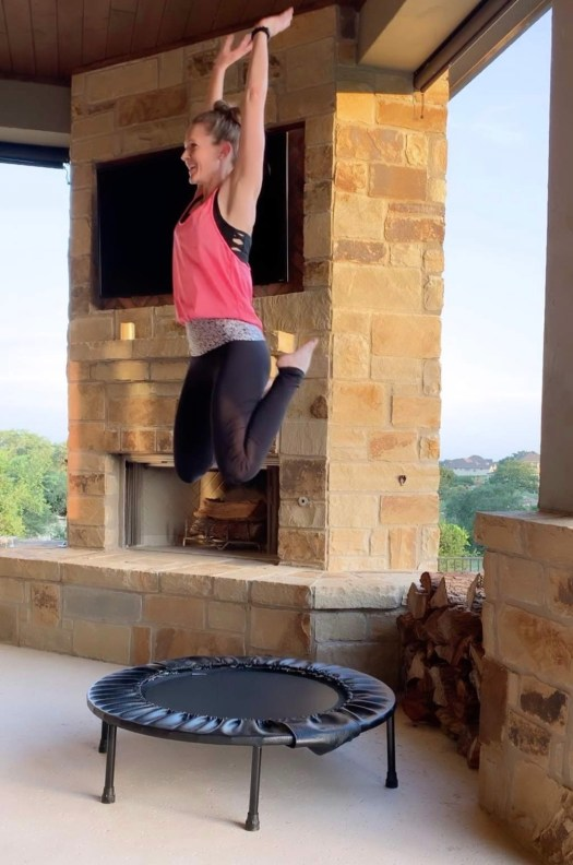 stephanie doing a jump on her Cellercise rebounder outside on the patio