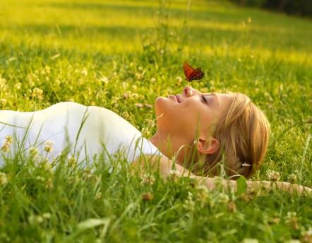 istock_000016995379medium-bhr-girl-lying-grass-butterfly[1]