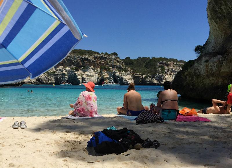 sunbathers Cala Macarelleta menorca