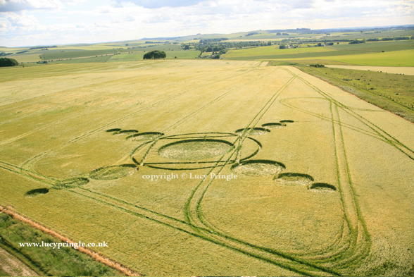 Green street, Nr Avebury, Wiltshire - 19th June 2015 Barley. c.120ft (37m) Four spirals of three circles of decreasing size attached to the outer ring of main circle containing a square with a flattened centre.