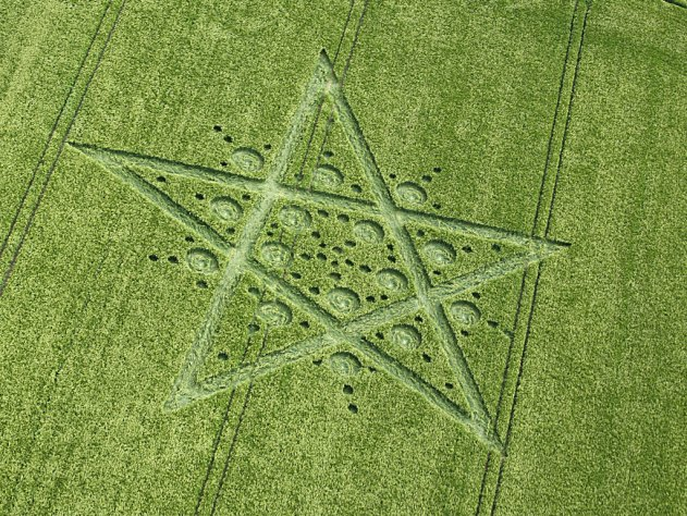 A pentagram containing 15 large circles which imply a pentagon. 45 small circles enhance the pentagon.
