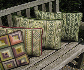 a group of Mountain & Wood pillows from the cross-point Collection