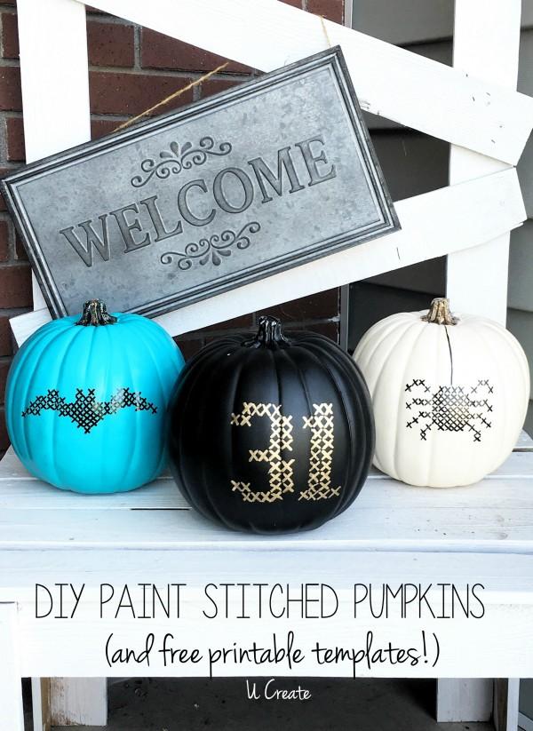 Painted pumpkins with cross stitch motifs.