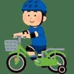 補助輪付き自転車に乗る男の子のイラスト