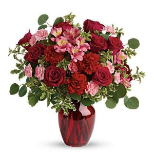 pink flowers red roses vase arrangement
