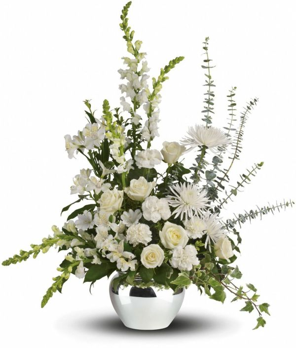 this gorgeous white arrangement has tall flowersthat adds architectural interest