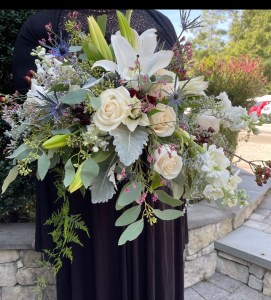 bouquet with lilies, roses, and eucalyptus