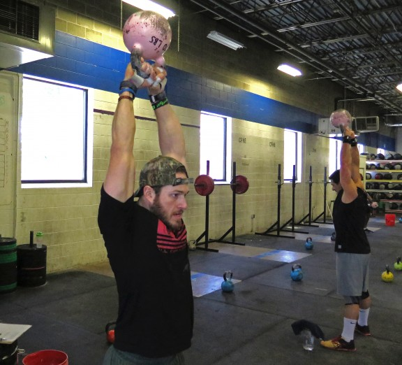 Mick Froning and Len showing the 70lb bubblegum kettlebell who's boss.