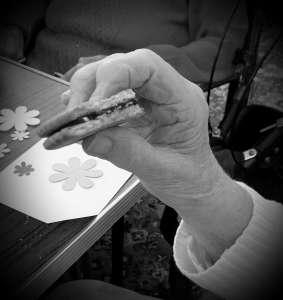 Elderly lady taking a biscuit break in community