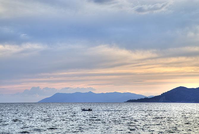 Boat crossing Fethiye Harbor s
