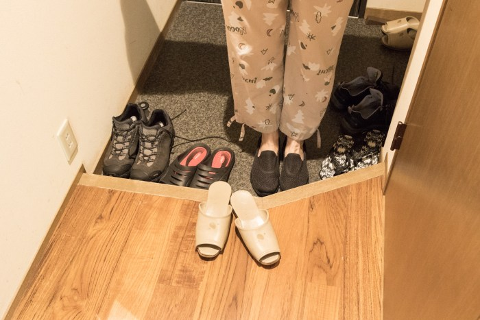 Wearing slippers.