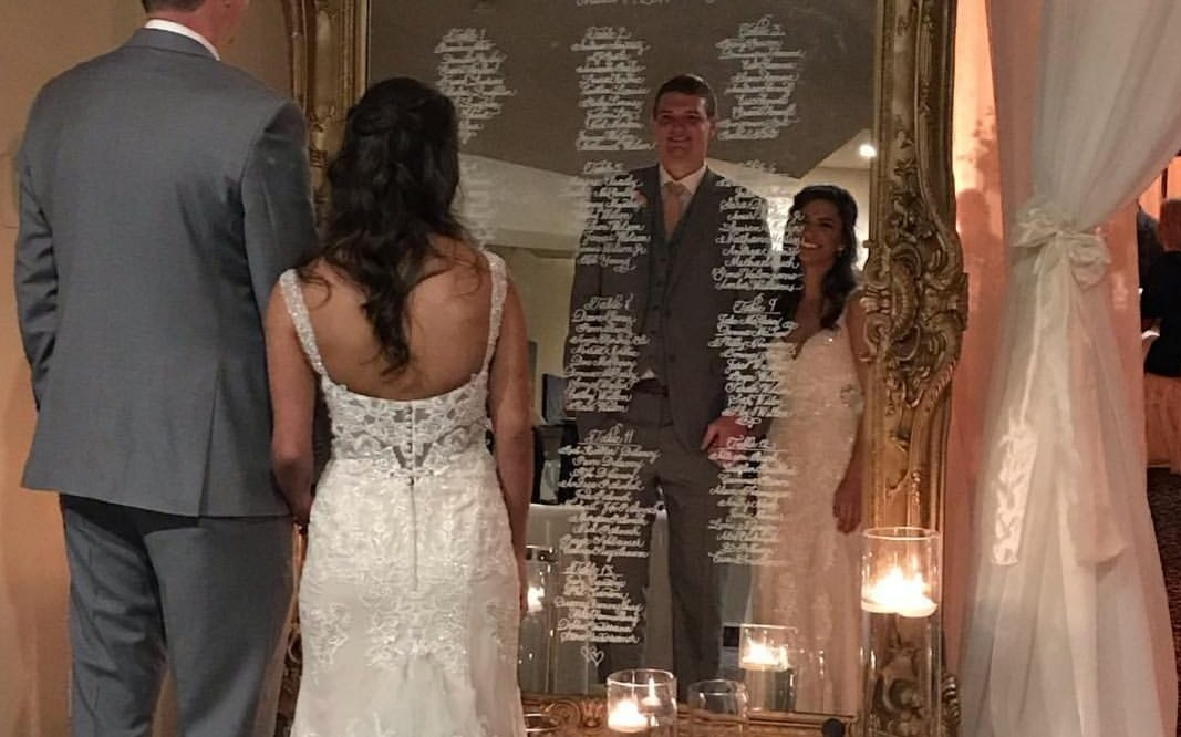 Calligraphy Seating Chart on a large mirror for spring Tucson wedding