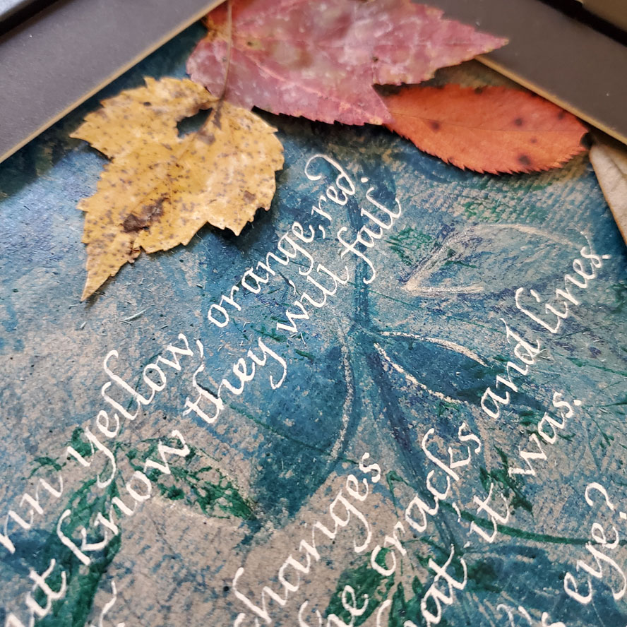 Custom Calligraphy -- an anniversary poem written in white calligraphy on a blue leaf-printed background.