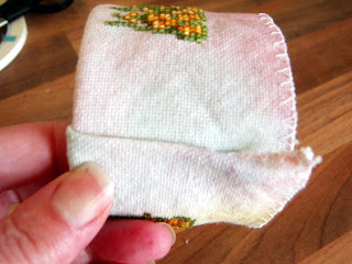 Stitched fabric end folded.