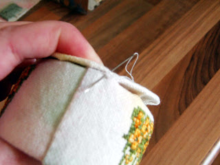 Stitch bottom onto tin.