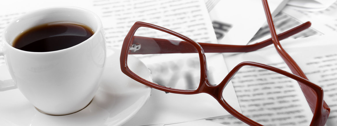 newspaper glasses and coffee