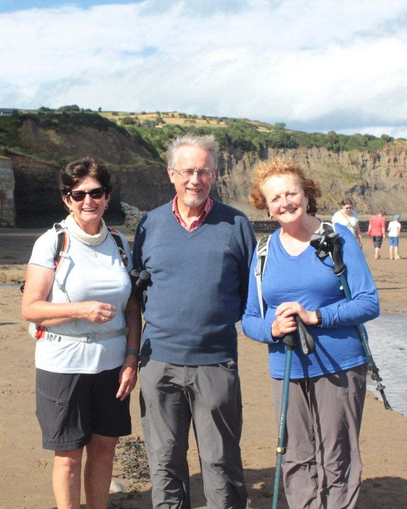 Helen Wallis, Patricia Anderson and Brain Dunning at the end of the Coast to Coast Walk in Robin Hoods Bay