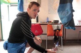 """Stoney drying his trousers after a """"drinks"""" leak from his rucksack."""