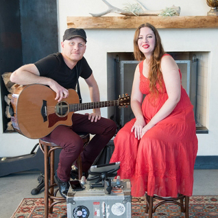 Image of Sara Wiley and guitarist at Austin Monthly event.