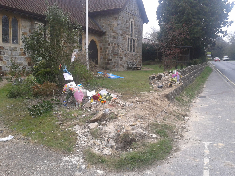 Floral tributes for the young men that died outside St Michael & All Angels Church in Jarvis Brook, Crowborough