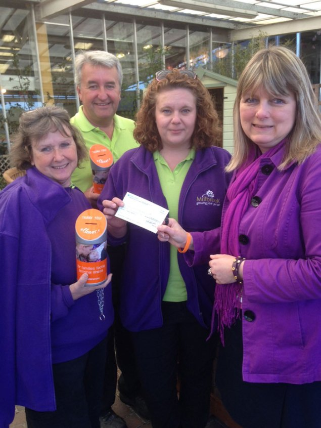 (From left to right) Suzie Vague, Plant Area Manager, John Simms, Garden Centre Assistant, Sarah Neve, Garden Centre Assistant Manager at Millbrook, Crowborough present the latest cheque for £5,944 on behalf of all the Millbrook Garden Centres to Angela Ward, ellenor (formerly chYps) Area Fundraiser.